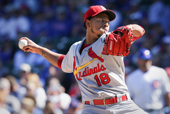 CHICAGO, IL - SEPTEMBER 20:  Carlos Martinez #18 of the St. Louis Cardinals delivers a pitch during the first inning against the Chicago Cubs at Wrigley Field on September 20, 2015 in Chicago, Illinois. The Cardinals defeated the Cubs 4-3. (Photo by John Konstantaras/Getty Images)