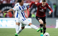 NUREMBERG, GERMANY - MARCH 31:  Hiroki Yamada of Karlsruher SC challenged L. Hufnagel of 1.FC Nuernberg during the Second Bundesliga match between 1. FC Nuernberg and Karlsruher SC at Arena Nuernberg on March 31, 2017 in Nuremberg, Germany.  (Photo by Adam Pretty/Bongarts/Getty Images)